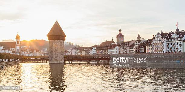 Switzerland, Canton of Lucerne, Lucerne, Old town, Reuss river, Chapel bridge and water tower at sunset