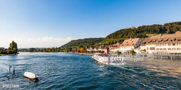 switzerland, canton of schaffhausen, stein am rhein, rhine river, tourboat, hohenklingen castle - bodenmeer stockfoto's en -beelden