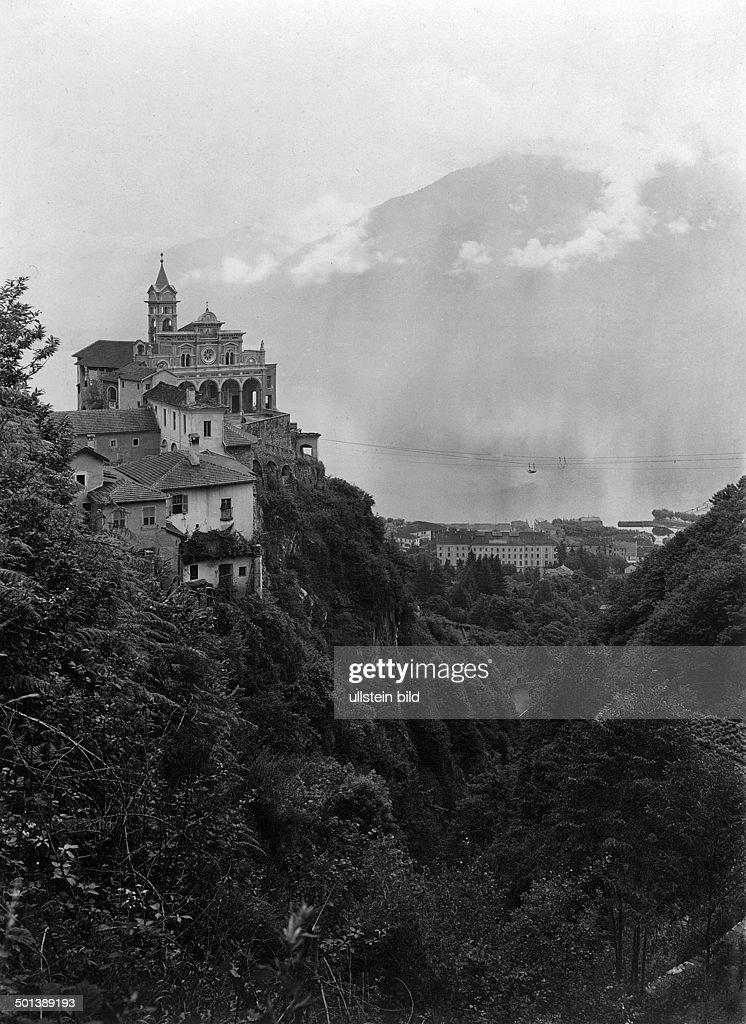 Switzerland, canton of Ticino: monastery Madonna del Sasso in Orselina on Lake Maggiore - probably in the 1910s : News Photo