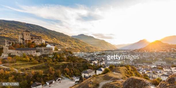 switzerland, canton vaud, sion, townscape with notre-dame de valere at sunset - rhone stock pictures, royalty-free photos & images