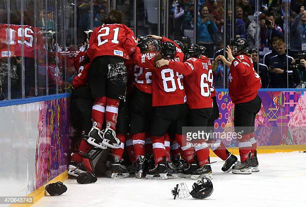 Switzerland celebrates after defeating Sweden 43 during the Ice Hockey Women's Bronze Medal Game on day 13 of the Sochi 2014 Winter Olympics at...