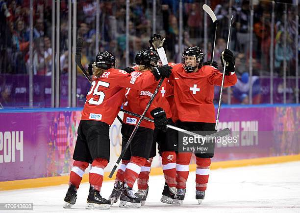 Switzerland celebrates after Phoebe Stanz scored a thirdperiod goal against Sweden during the Ice Hockey Women's Bronze Medal Game on day 13 of the...