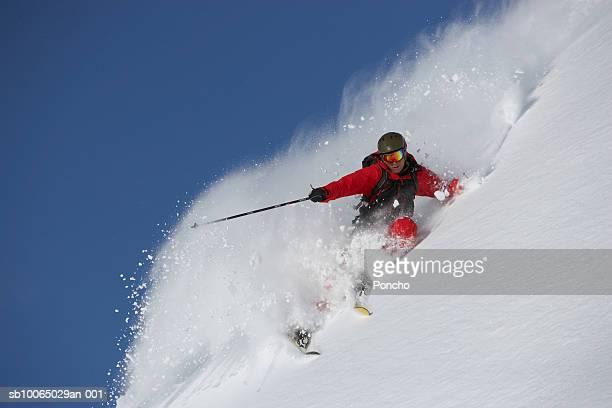 switzerland, davos, person downhill skiing, low angle view - kanton graubünden stock-fotos und bilder