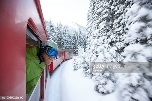 switzerland, davos, skier looking out of train window - davos stock pictures, royalty-free photos & images