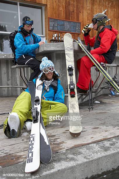 switzerland, davos, three skiers resting at outdoor bar - apres ski stock pictures, royalty-free photos & images