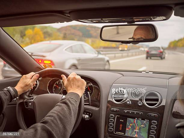 Switzerland, driving car on motorway