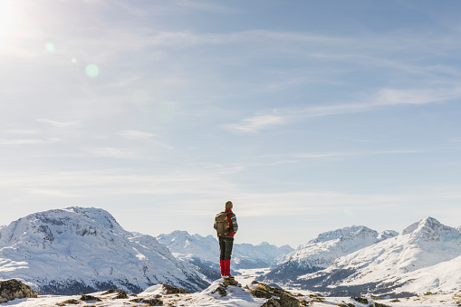 Switzerland, Engadin, hiker in mountainscape looking at view - gettyimageskorea