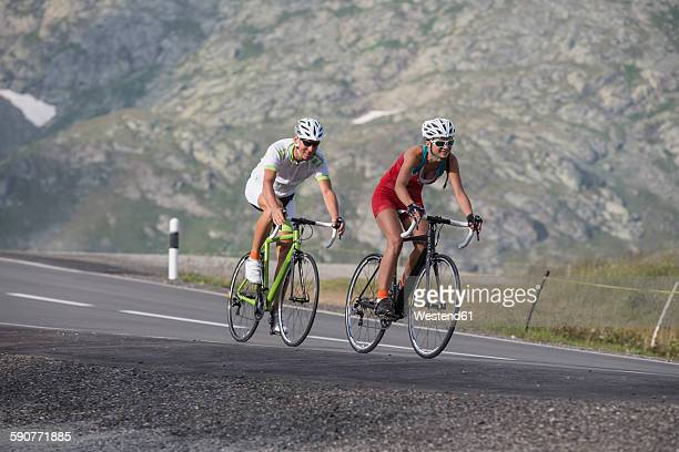 Switzerland, Engadin, two cyclists on Bernina Pass