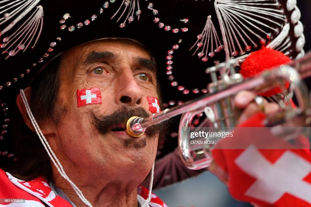 Switzerland fan cheers on the team before their Russia 2018 World Cup Group E football match between Serbia and Switzerland at the Kaliningrad Stadium in Kaliningrad on June 22, 2018. (Photo by OZAN KOSE / AFP) / RESTRICTED