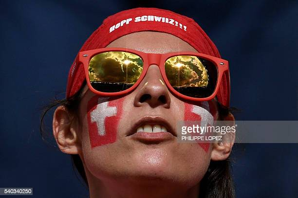 Switzerland fan is pictured ahead of the start of the Euro 2016 group A football match between Romania and Switzerland at the Parc des Princes...