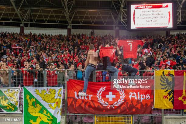 Switzerland fans celebrate the win after the UEFA Euro 2020 qualifier between Switzerland and Republic of Ireland on October 15 2019 in Geneva...