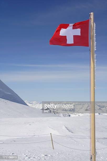 Switzerland - flag and winter alps