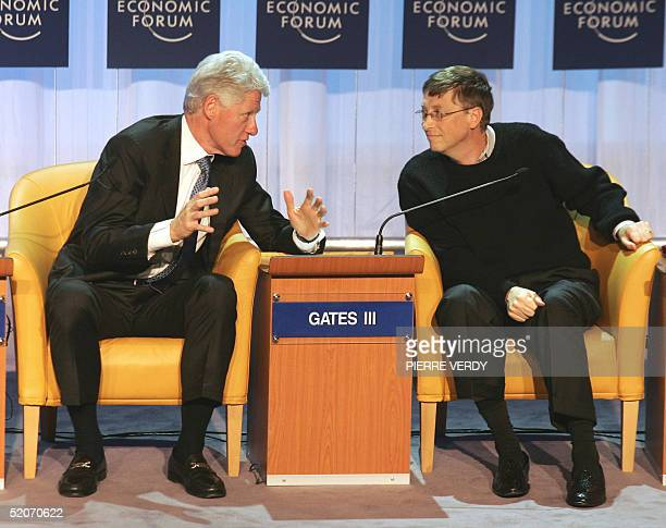 Former US President Bill Clinton talks with US Microsoft chairman Bill Gates during The G8 and Africa Rhetoric or action session at the World...