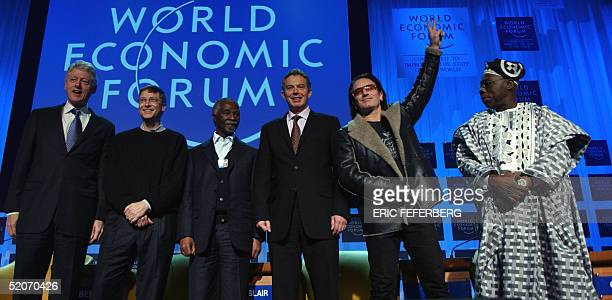 Former US President Bill Clinton US Microsoft chairman Bill Gates South African President Thabo Mbeki British Prime Minister Tony Blair Irish singer...