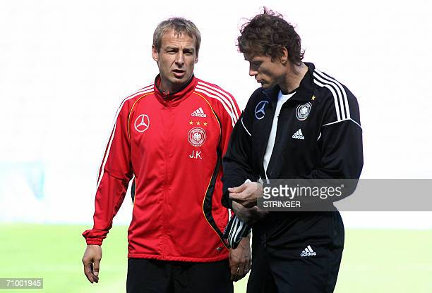Germany's goalkeeper Jens Lehmann confers with coach Juergen Klinsmann prior to a training session of the German national football team at the Stade...