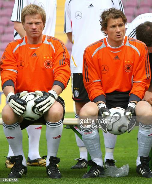 Germany's goalkeepers Oliver Kahn and Jens Lehmann sit side by side as Germany's national football players and their trainers gather to pose for a...
