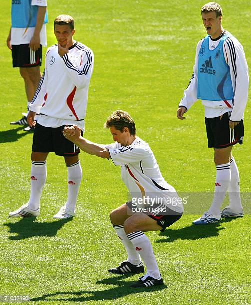 Germany's players Lukas Podolski and Robert Huth watch Miroslav Klose during a training session of the national football team at the Stade de Geneve...
