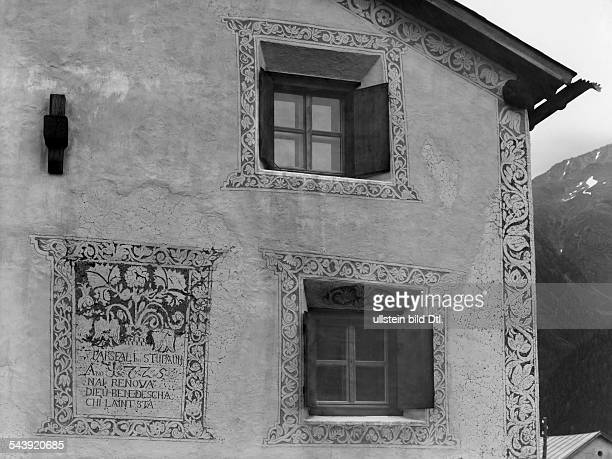 Switzerland Graubuenden: Lower Engadin: facade of an old building with ornaments in the traditional style of the Engadin region in Guarda - 1954-...