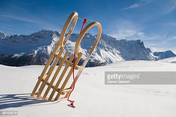 Switzerland, Graubuenden, Savognin, sledge in snow