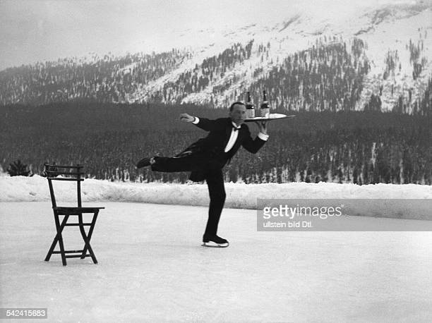 Switzerland Graubuenden St Moritz waiter on ice skates with a tray with two bottles 1932 Photographer Alfred Eisenstaedt Published by 'Die Dame'...