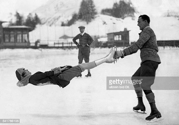 Switzerland Graubuenden St Moritz Winter Sports the ice skaters Phil Taylor and Freda Whitaker perfoming an aeroplan spin Photographer Sport General...