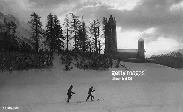Switzerland Graubuenden winter skier at sunset Photographer Carl Heller Published by 'Dame' 8/1914Vintage property of ullstein bild