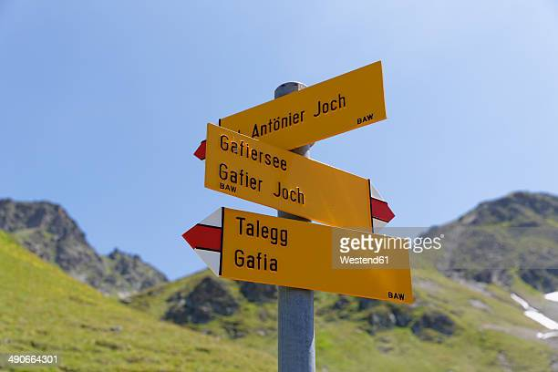 Switzerland, Grisons, Sign post at Lake Grafiersee