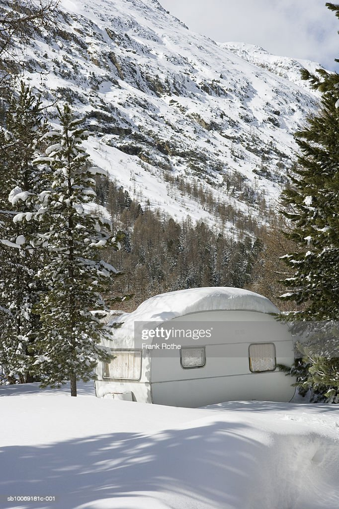 Switzerland, House covered with snow : Stockfoto