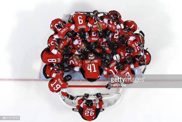 Switzerland huddel around the net before their game against Japan during the Women's Ice Hockey Classification game on day eleven of the PyeongChang...