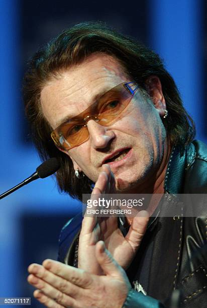 Irish rock star Bono talks during the session 'The G8 and Africa Rhetoric or action ' at the World Economic Forum in Davos 27 January 2005 Rock star...