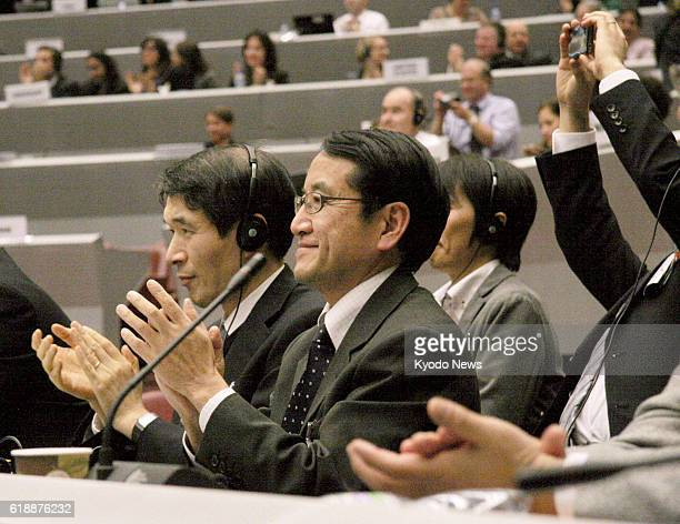 GENEVA Switzerland Japanese government representatives applaud after negotiators agreed in accordance with Japan's proposal to name a new...