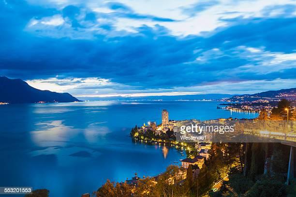 switzerland, lake geneva, montreux, cityscape at dusk - montreux stock pictures, royalty-free photos & images