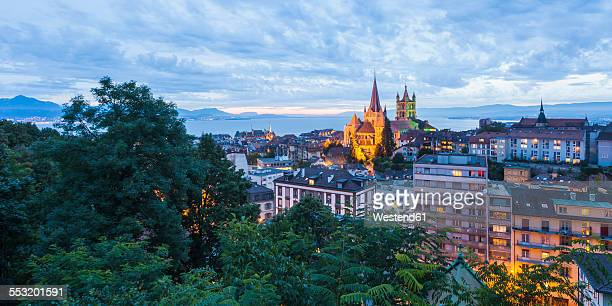 switzerland, lausanne, cityscape with cathedral notre-dame at dusk - lausanne stock pictures, royalty-free photos & images