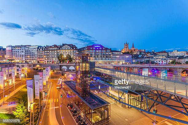 switzerland, lausanne, traffic in the city at dusk - lausanne stock pictures, royalty-free photos & images