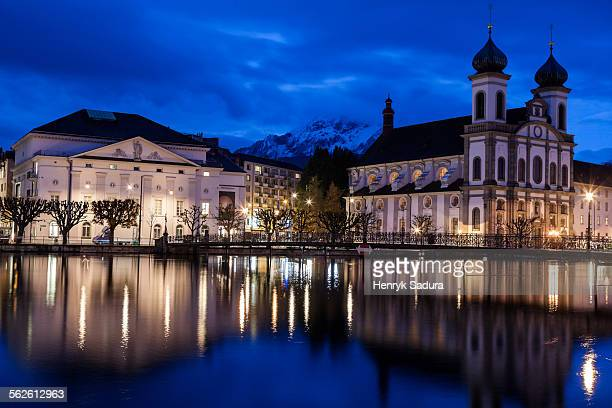 Switzerland, Lucerne, Illuminated building reflecting in lake