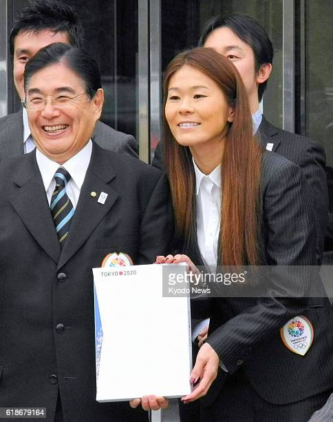 LAUSANNE Switzerland Masato Mizuno the CEO of the Tokyo 2020 Bid Committee and Olympic silver medalwinning soccer player Homare Sawa pose for photos...