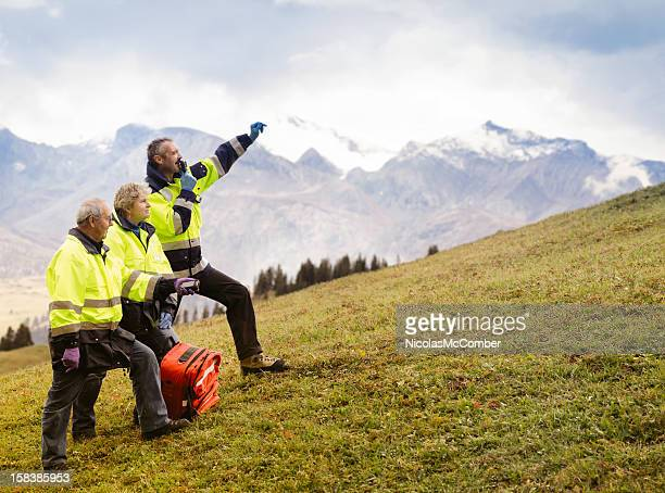 switzerland mountain rescue team signaling - rescue worker stock photos and pictures