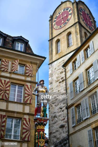 """Neuchatel. Typical apartment building in the city center and restored Banneret Fountain with the statue of Laurent Perroud on top, Òrue du Chateau""""..."""