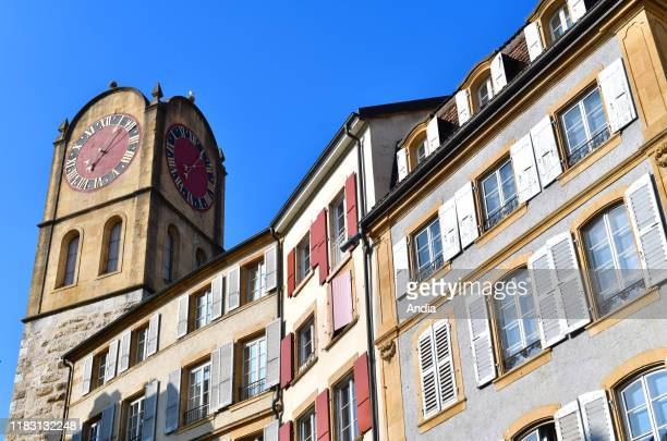 "Neuchatel. Typical apartment building with colorful facades in the city center, Òrue du Chateau"" street, Croix-du-Marche square."