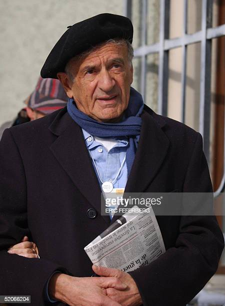 Nobel Peace Prize laureate Elie Wiesel walks in Davos' street before attending a holocaust commemoration ceremony at the Davos city hall 26 January...