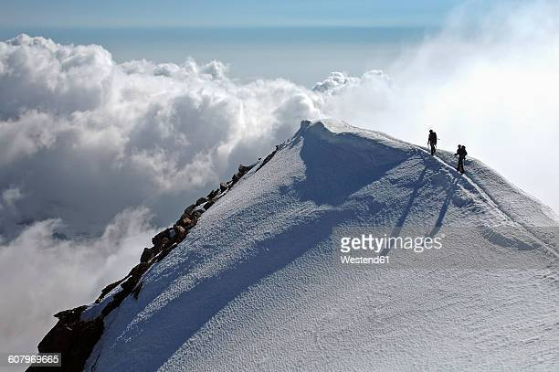 switzerland, pennine alps, saas-grund, weissmies, mountaineers - summit stock pictures, royalty-free photos & images