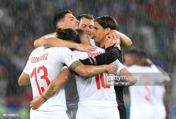 Switzerland players celebrate following their sides victory in the 2018 FIFA World Cup Russia group E match between Serbia and Switzerland at...