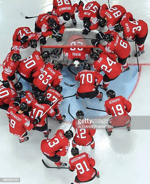 Switzerland players gather around their goalkeeper during a IIHF International Ice Hockey World Championship preliminary round group B game between...
