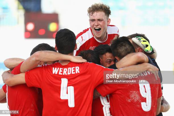 Switzerland players including Dejan Stankovic Glenn Hodel Nicola Werder and Mo Jaeggy celebrate victory in the penalty shootout during the FIFA Beach...