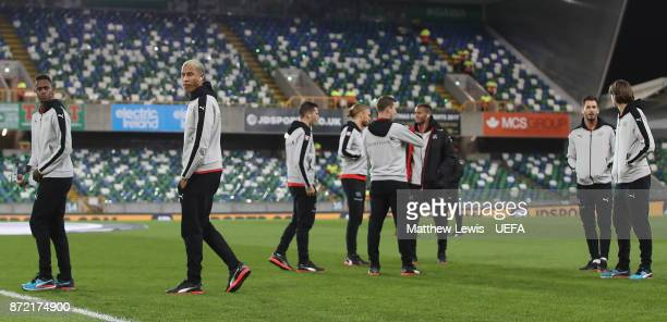 Switzerland players inspect the pitch ahead of the FIFA 2018 World Cup Qualifier PlayOff First Leg between Northern Ireland and Switzerland at...