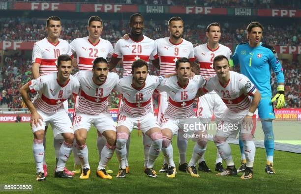 Switzerland players pose for a team photo before the start of the FIFA 2018 World Cup Qualifier match between Portugal and Switzerland at Estadio da...