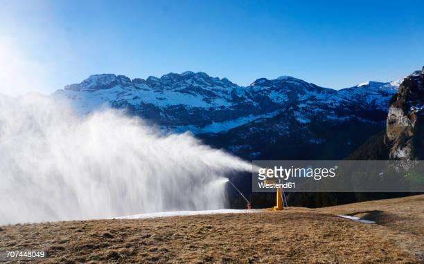 switzerland, portes du soleil, champery, active snow cannon - fake snow stock pictures, royalty-free photos & images