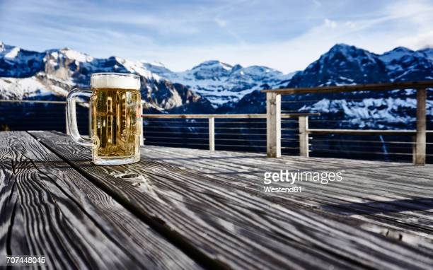 Switzerland, Portes du Soleil, Champery, mug of beer on rustic tabletop
