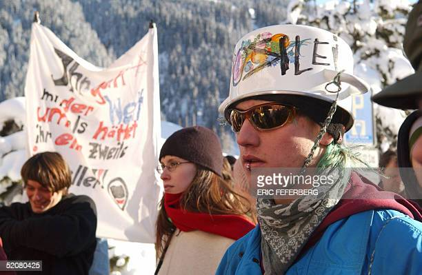 Protestors walk through Davos street 29 January 2005 Demonstrations were held in Switzerland on Saturday against the World Economic Forum being held...