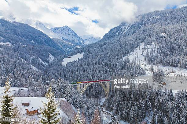 Switzerland, Rhaetian railway passing through Langwieser Viaduct bridge